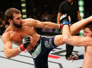 Luke-Rockhold-kicks-Michael-Bisping---Josh-Hedges-Zuffa-LLC